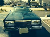 This car is a 1985 Cadillac Eldorado. It is black with