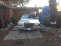 1985 cadillac seville White, with blue leather interior