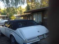 1985 cadillac seville. 80.000 original miles.White with