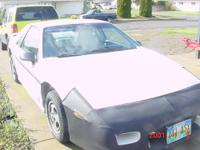 This a 1988 Pontaic Fiero With V6 Engine. It has