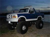 1985 Ford Bronco with a 1996 front end. Custom Paint
