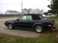 2 door-Black with red pinstripe convertible with grey