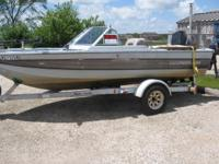 This boat has a 115 1994 horse Merc 2x2 outboard and a