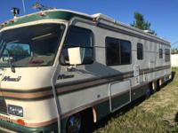 Well cared for motor home with walk around queen bed.