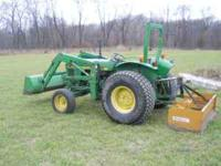 1986 John Deere 1050 33 hp Diesel with front loader.