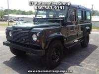 This is a 1986 Land Rover Defender 110 that has a 1999