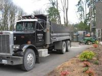 1986 Peterbilt dump truck. It has a Workman 16 dump box