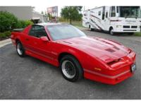 Beautiful Bright Red Pontiac Trans Am that is in
