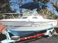 23 foot Aquasport Express Fisherman Offshore 222 and