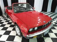 This 1987 BMW 3 Series 2dr 325iC Convertible features a