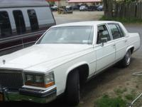I HAVE A CLASSIC 1987 CADILLAC BROUGHAM, 307