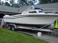 "1987 Grady-White 22 Seafarer on ""Float On"" trailer."