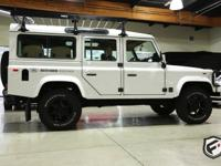 This is a 1987 Land Rover Defender 110, Left Hand Drive