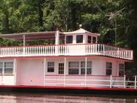 Type of Boat: two story steel deck houseboat Year:
