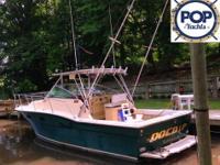 This classic 1988 Aquasport 290 Express Fisherman was