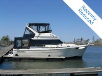 This Bayliner 3218 is powered by twin Marine Power 305k