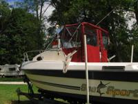 18 ft white with blue trim 1988 bayliner cuddy cabin