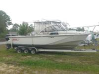 27 ft. Boston Whaler and triple axel trailer.
