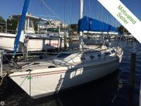The 1988 Catalina 34 tall - with a mast of 52 feet in