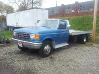 for sale is a 1988 f350 rollback car hauler with a 7.5