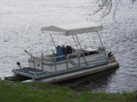 We purchased this 18' Kennedy pontoon boat in St. Paul,
