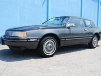 This is a 1988 Mercury Cougar that is completely loaded