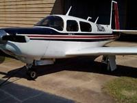 This 1988 Mooney M20K 252TSE is always hangered and