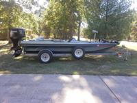 "1989 Aries tri-hull bass boat. Boat is 18'6"" long."