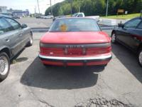 1989 Buick Reatta Color is red Tan leather interior