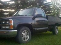 1989 Chevy C1500 with a wooden bed 2 Wheel Drive 350