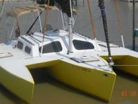 This is a custom made Cross 24' trimaran. Made of West