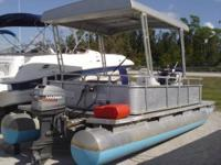 Here is a great old boat. A 1989 FunTime 20 Pontoon. It