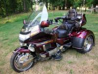 1500cc 39K miles, deep burgundy with blue/gold/orange