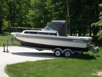 1989 Imperial 23 foot, with Bimini top, side and drop
