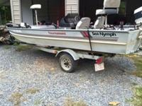 15.5 ft, 30 hp Evinrude carpet and wood 1 1/2 years