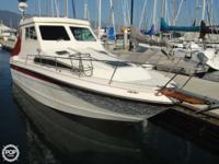 This is a very unique 1989 Sea Ray 268. Her customized
