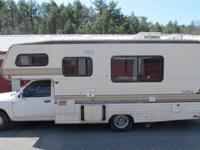...,1989 Toyota 22' class C camper. The driver's