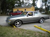 It is gray on gray with original caprice rims and white