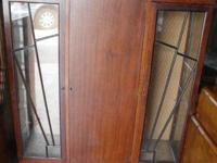 It has 2 glass insert doors with attractive wood trim,