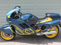 This is a 1990 BMW K1 in immaculate condition. It has
