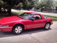 For sale a beautiful red Buick Reatta. This car is all