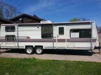 Must see this clean Coachman Classic 25 ft. M230 model.
