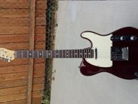 This is a USA made 1990 Fender Tele with a rosewood
