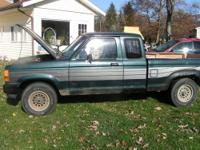 This is A 1990 Ford 4x4 Extended Cab Ranger. Good