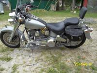 I have the original leather saddle bags, windshield,