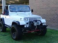 This 1990 Jeep Wrangler (6 banger) 4 WD was restored