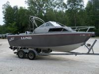 Very. very nice boat. 166 HP. cuddy cabin. with bimini