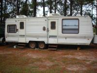 CAMPER READY FOR RIVER LOT OR HUNTING CAMP. HAS ALL