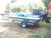 UP FOR SALE IS A 1990 STRATOS 18FT BASS BOAT, WITH 150
