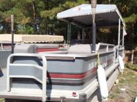 1990 Sun Tracker 24 DL w/35hp Mercury. Short term